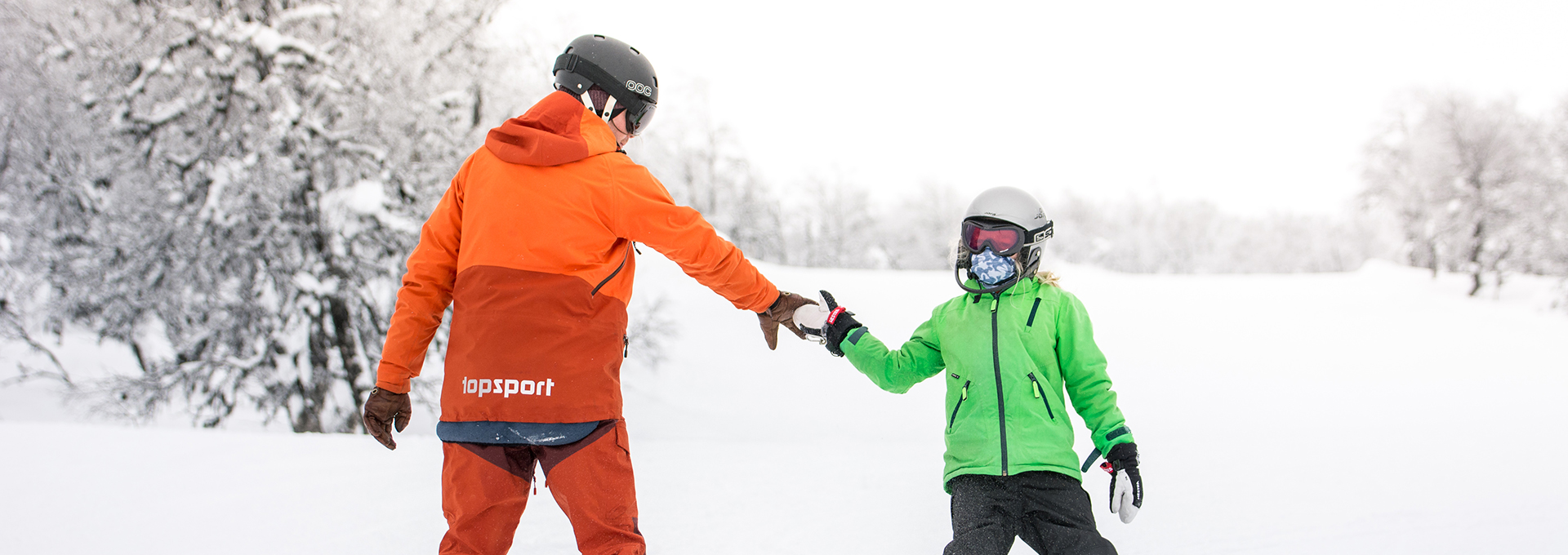 Children at snowboarding lesson
