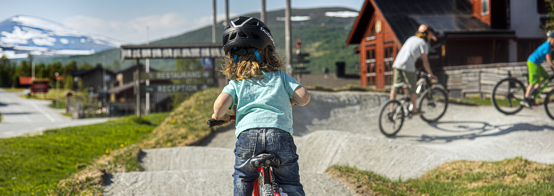 children and youths at the pump track in Ramundberget