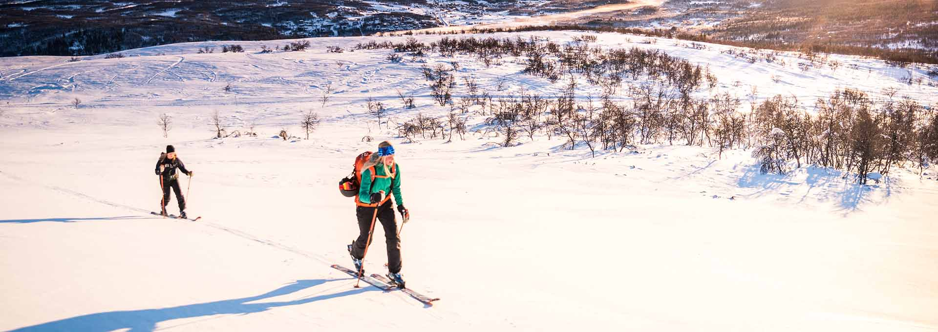 Two persons try out ski touring